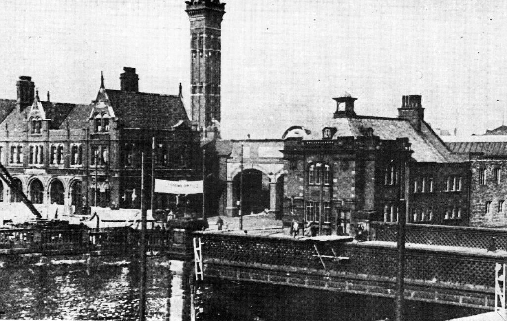 The River Mersey in the foreground with the Fire Station and it's hose drying tower in the background - now Mersey square