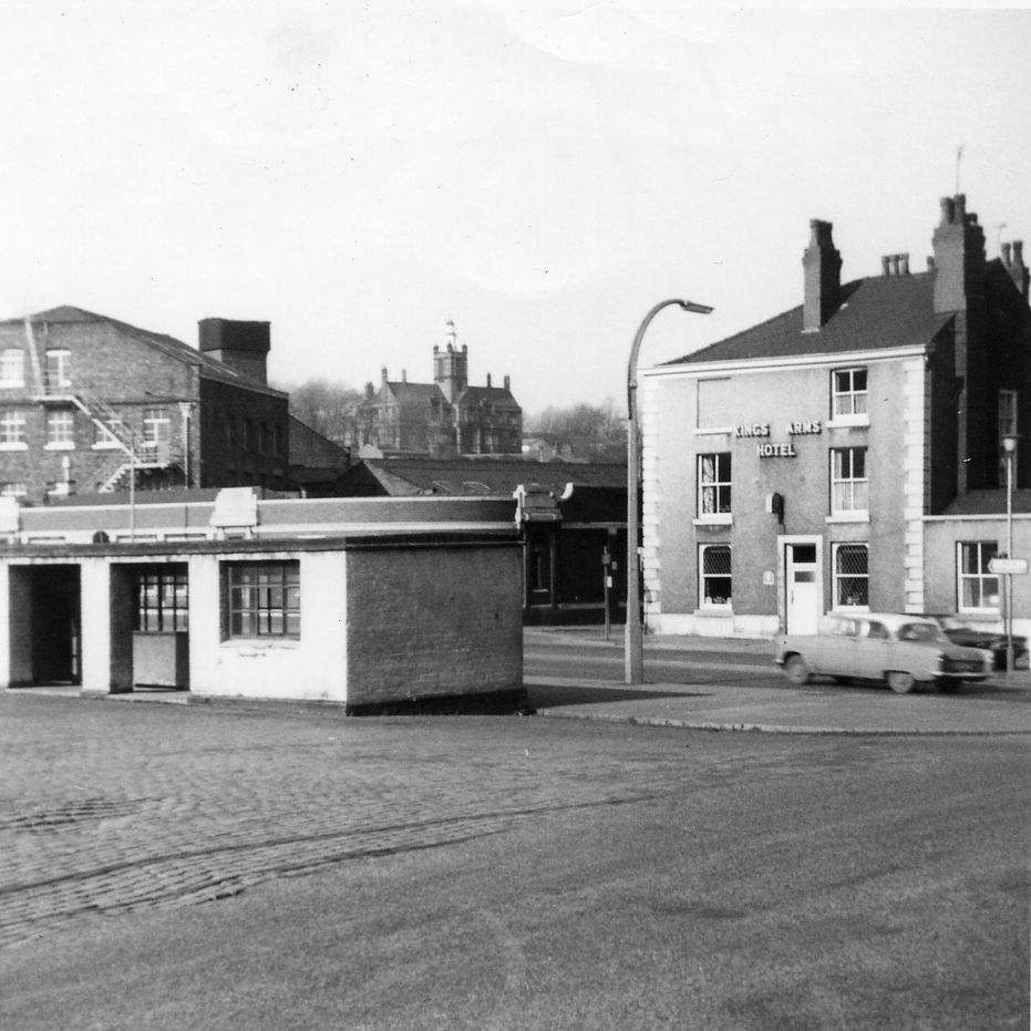Andrew Square 1960s. Bus shelter with Pendlebury Hall in the background. Asda is now on the far left.