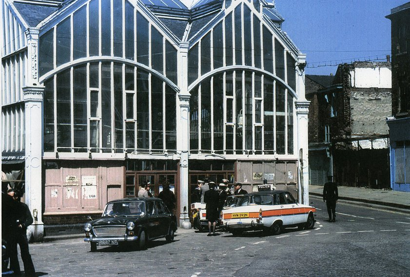 Market Hall 1975 with police outside