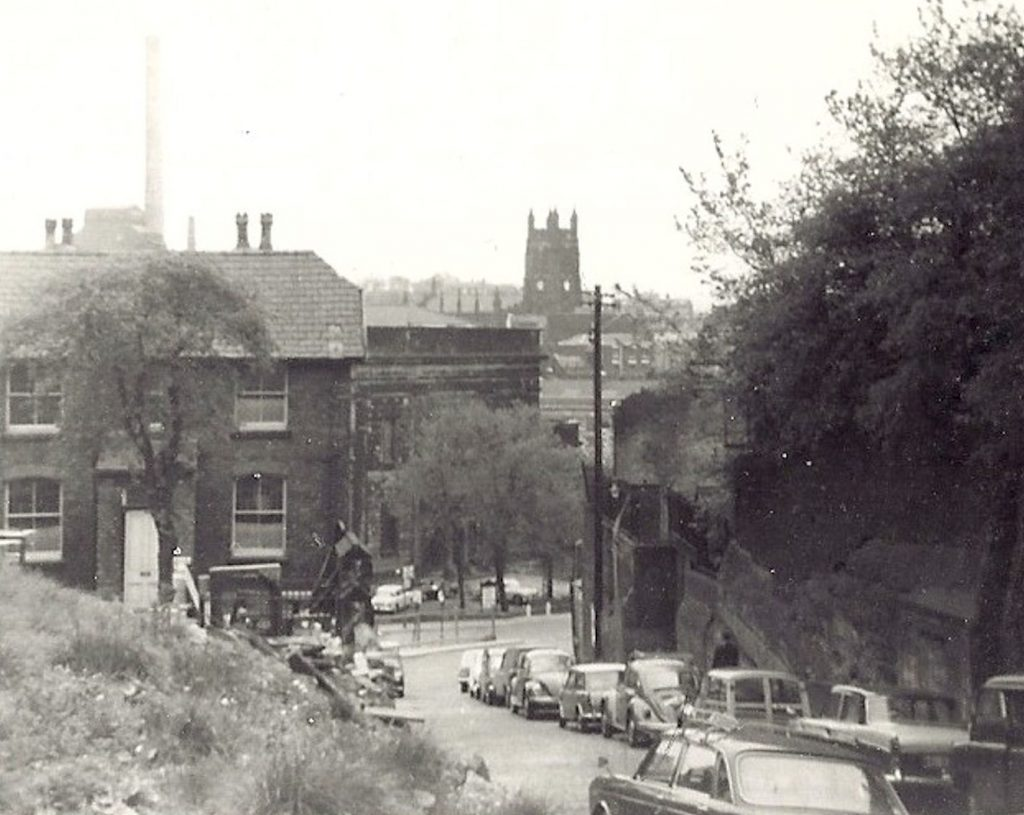 Looking down Dodge Hill in the 1970s. Tiviot Dale Methodist Church is visible at the bottom of the hill, before it's demolition.