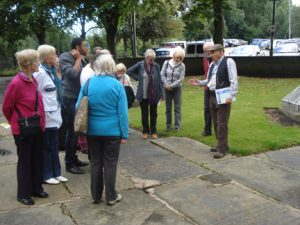 Group of people on a tour around St. Mary's graveyard