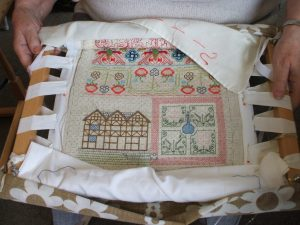 Portion of sampler showing black and white Staircase House